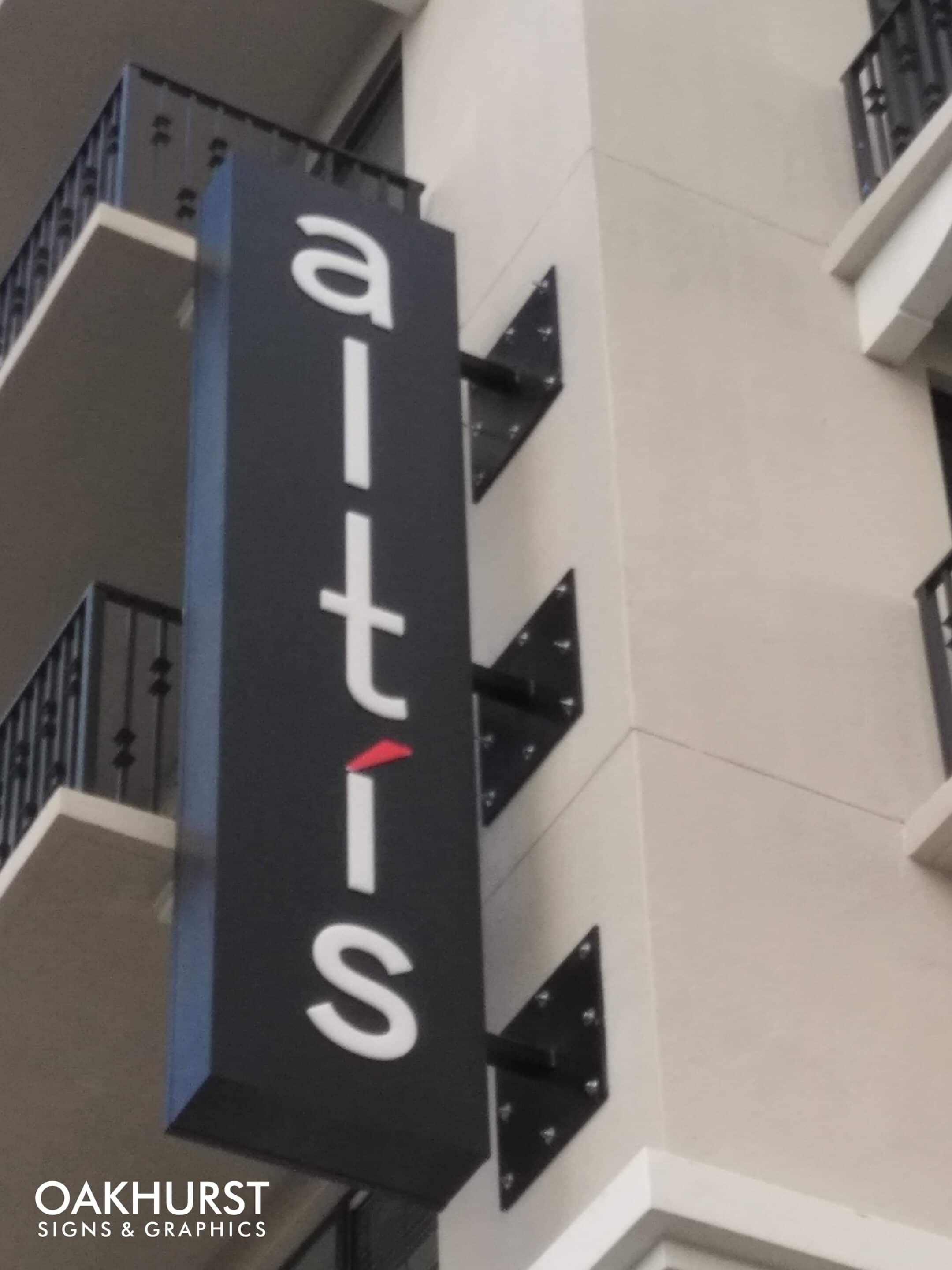 Altis blade sign on building exterior