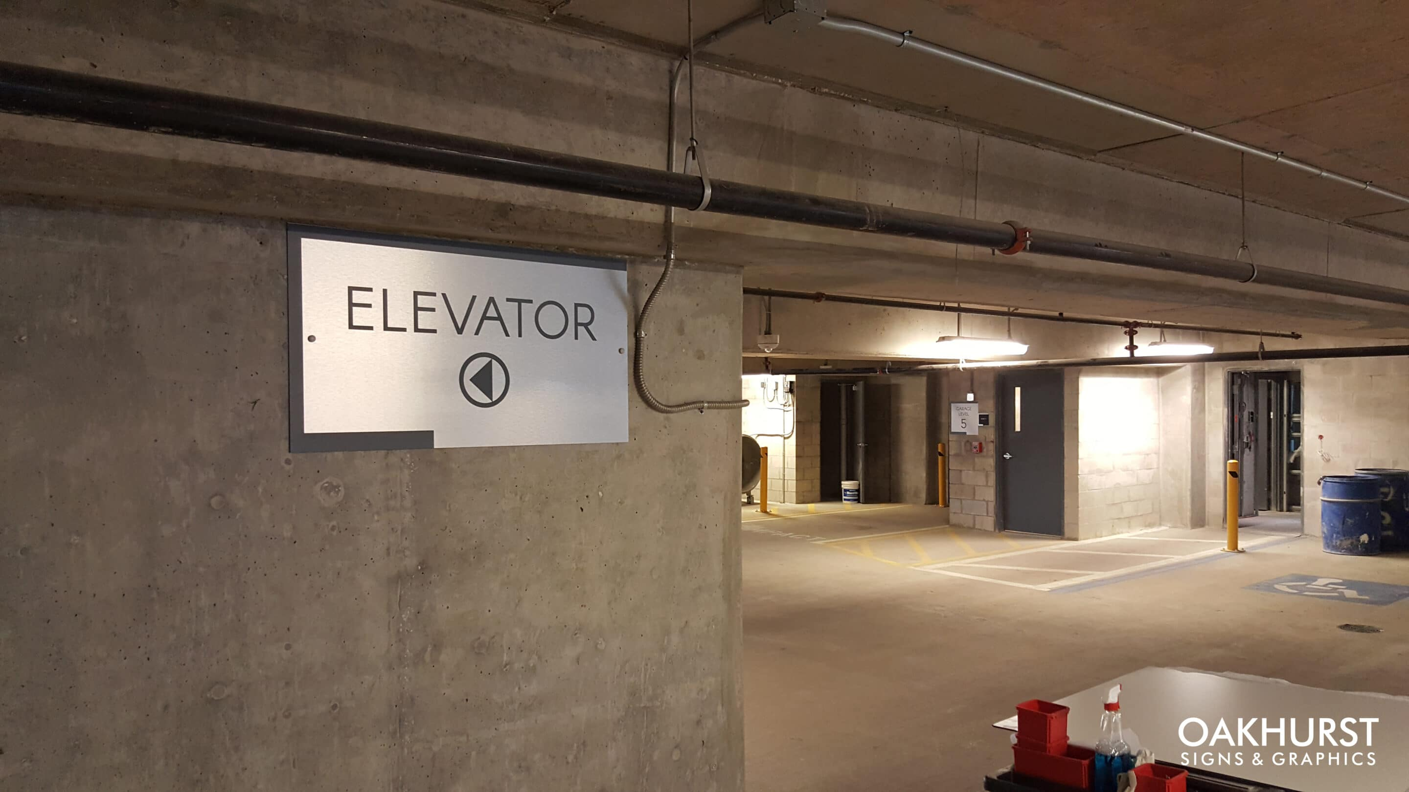 Altis elevator sign in parking structure