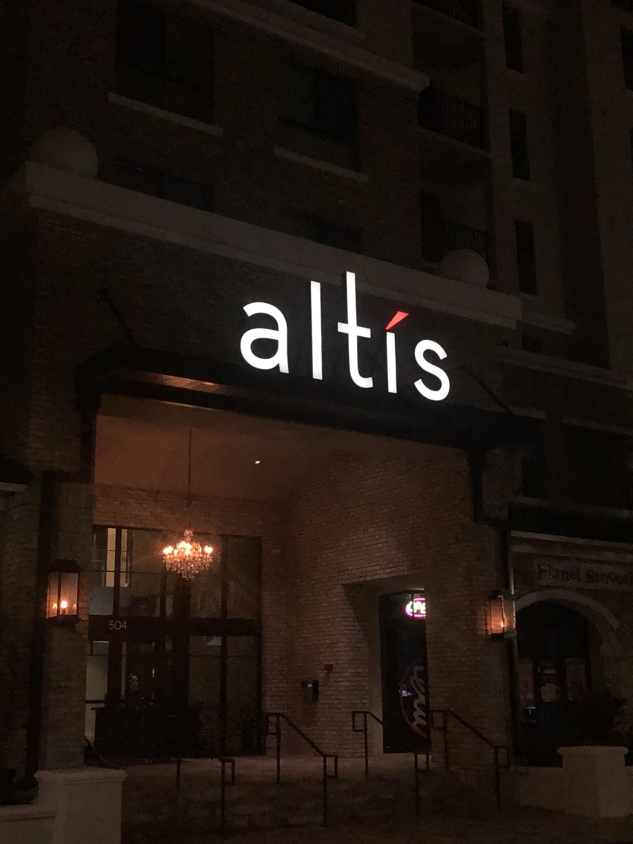 Altis exterior building sign over entry