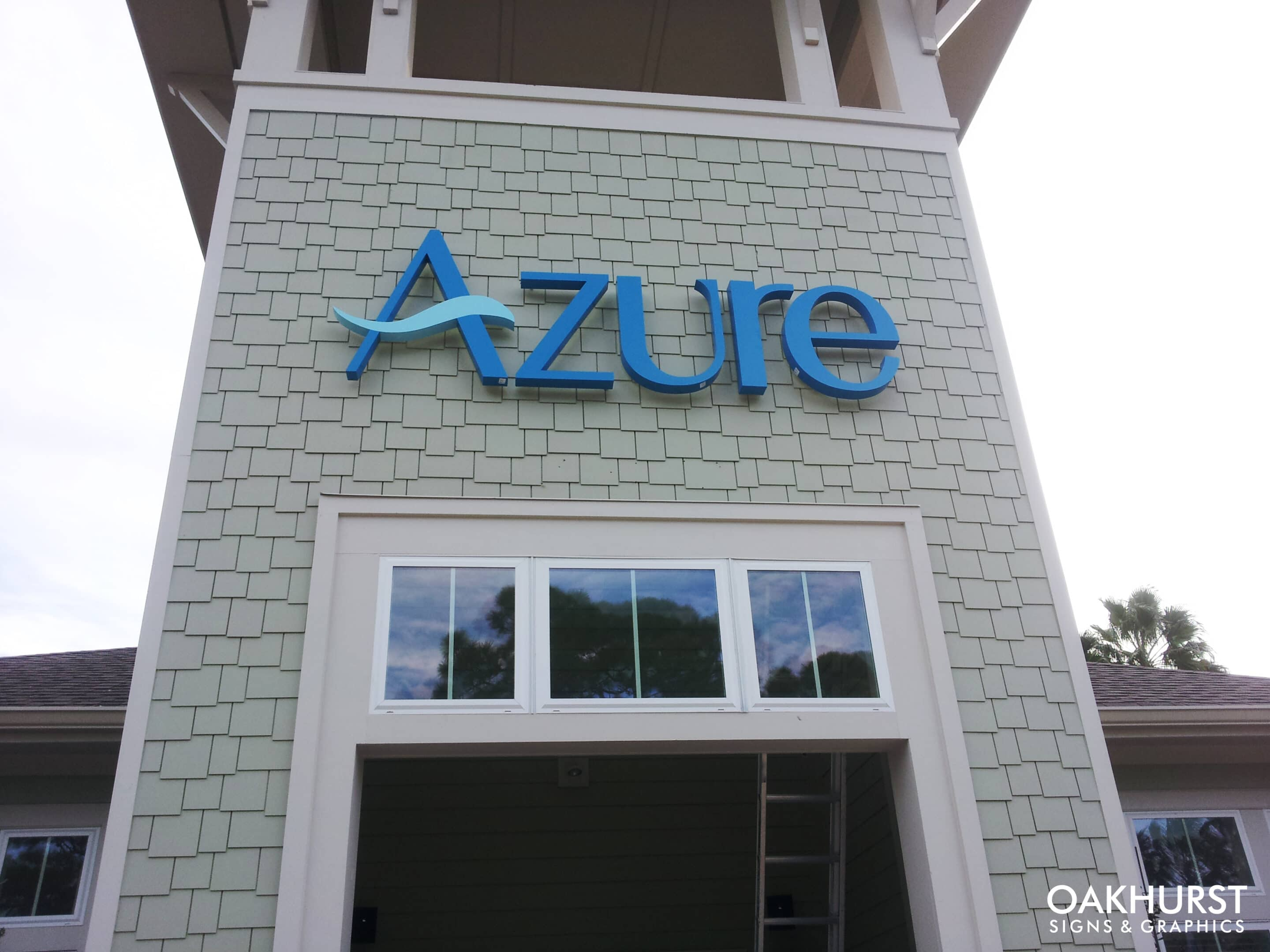 Azure PVC channel letters attached to building