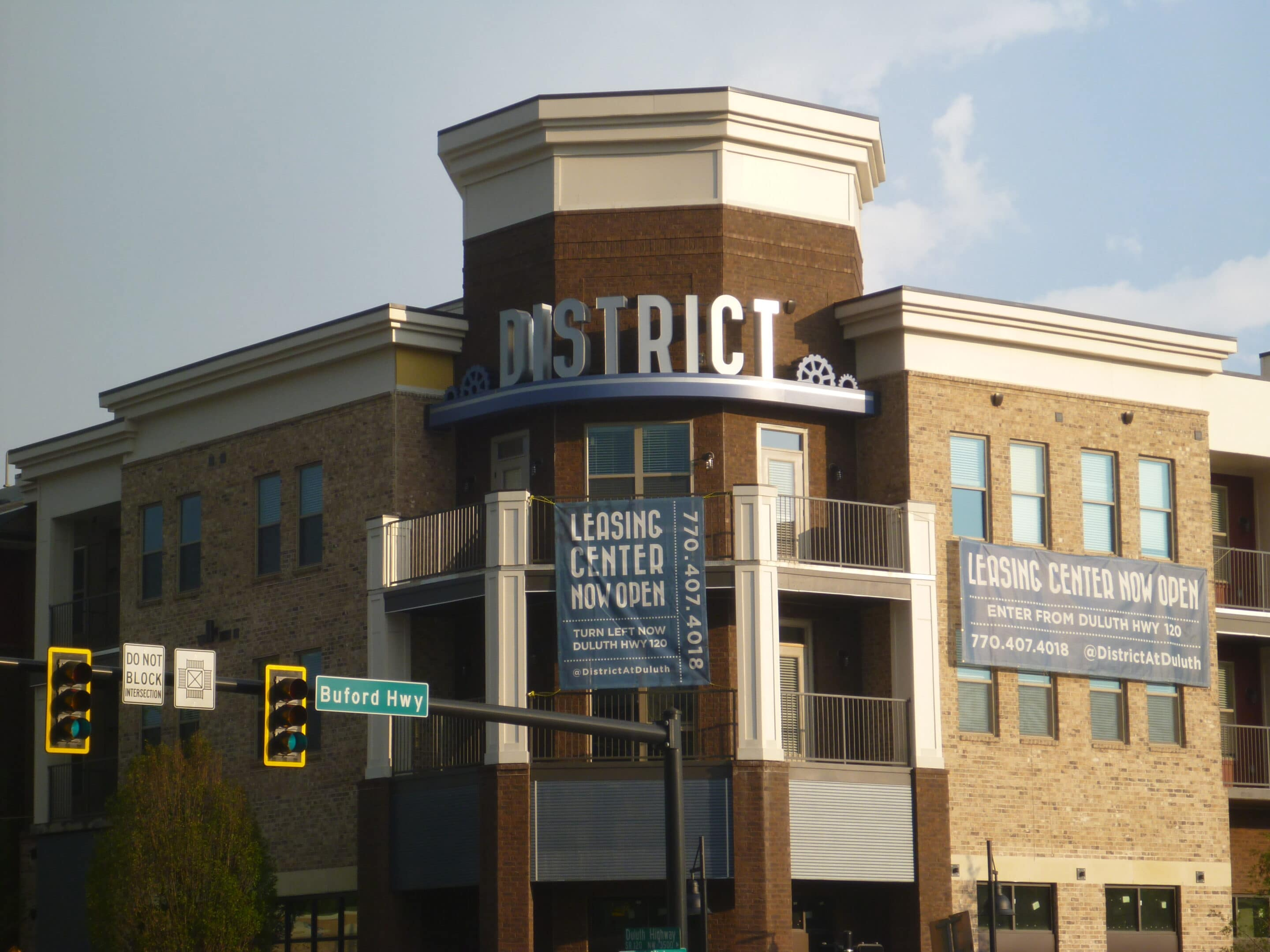 District at Duluth channel letters rounding corner of brick building