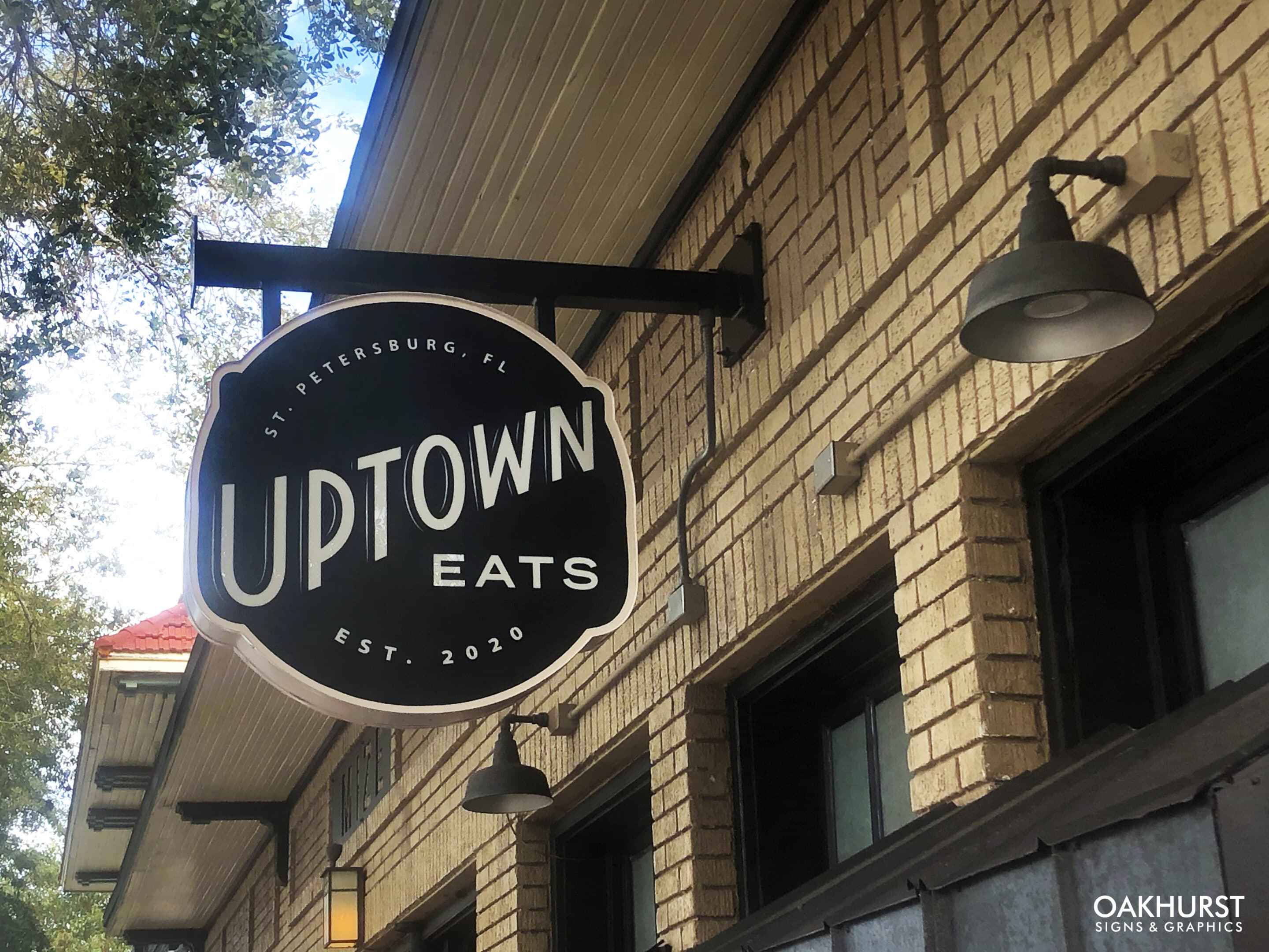 Uptown eats exterior blade sign on building