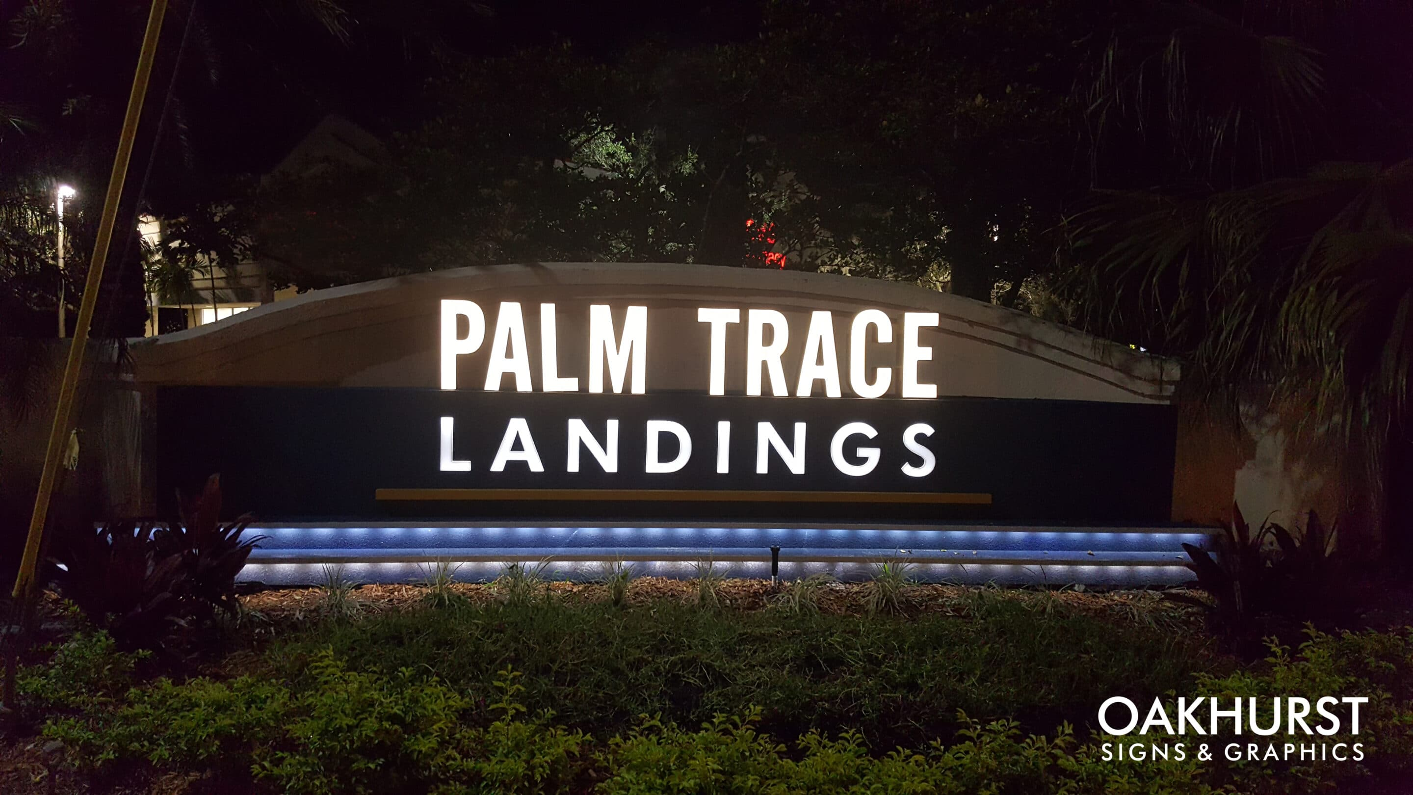Palm Trace Landings Channel letters illuminated at night